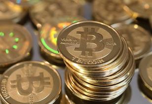 Биткоины могут произвести революцию в финансовом мире.